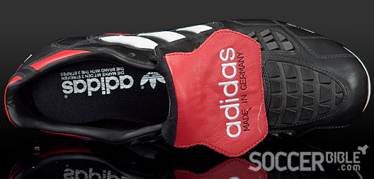 new arrival 04043 1c6c7 The adidas Predator Touch football boots introduced the Predator s  distinctive red tongue, which was elongated so it could fold and cover the  laces, ...